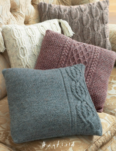 Four cushions with various cable knit designs