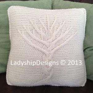 Cable tree of life design on a knit pillow