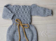 Grey knitted romper for baby or toddler girl, with long sleeves, drawstring at waist and buttons between leg openings for easy diaper change