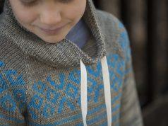 Geometric stranded colorwork on knit sweater yoke