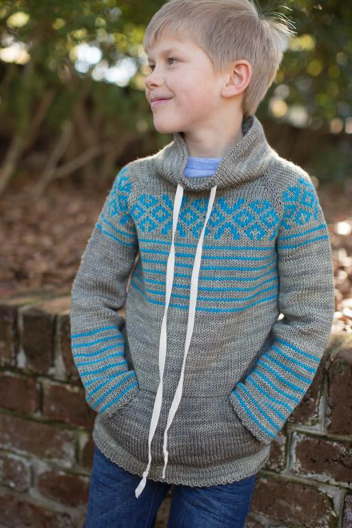 Knit kangaroo sweater with raglan sleeves and geometric pattern