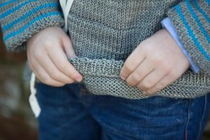 Built-to-let-out hem on a knit sweater for kids