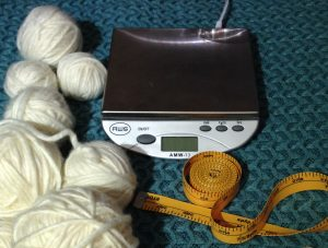 Digital scale, measuring tape and mystery yarn to determine yardage